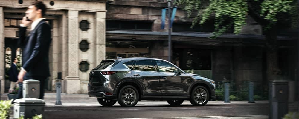 Mazda CX-5 Driving Down City Street