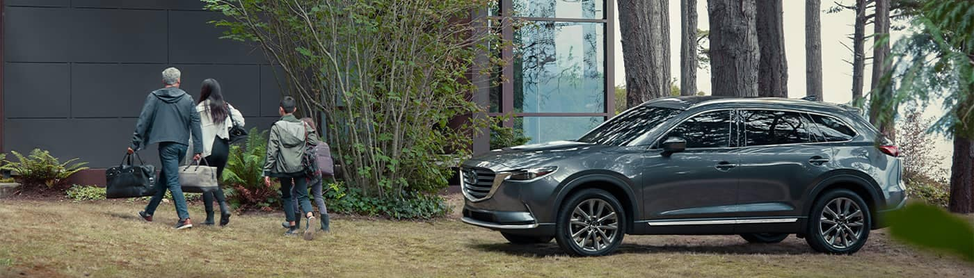 Mazda CX-9 Parked Outside Lake House
