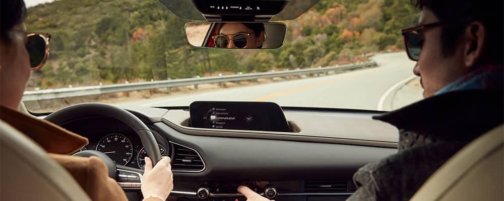 Couple driving in Mazda CX-30