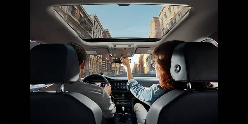 Couple driving in Volkswagen Jetta